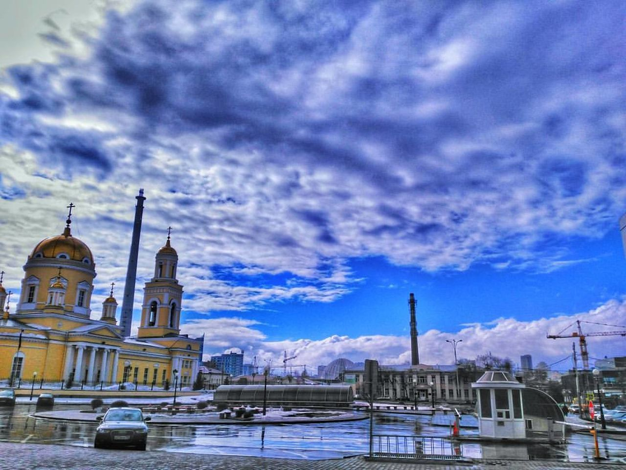 architecture, built structure, building exterior, cloud - sky, sky, religion, place of worship, spirituality, weather, outdoors, no people, transportation, dome, water, day, travel destinations, city, nature, cold temperature, snow