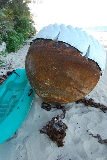 Rusty Buoy on the beach. Beachcomber Island. Fiji Water No People Day Close-up Land Rusty Metal High Angle View Outdoors Rock Beach Solid Buoy Marine