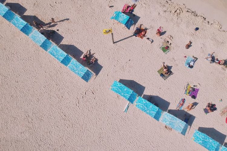 In front of the tent please. DJI X Eyeem Dronephotography From Above  Drone  Sand Sunblock Umbrella Beach Tents Shadow Sand Land Beach High Angle View Sunlight Nature Day Shadow Multi Colored Holiday Summer Vacations Trip Sunny Outdoors Leisure Activity Beach Holiday People The Traveler - 2018 EyeEm Awards The Traveler - 2018 EyeEm Awards