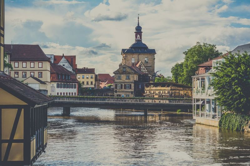 Altes Rathaus By River Against Sky At Bamberg