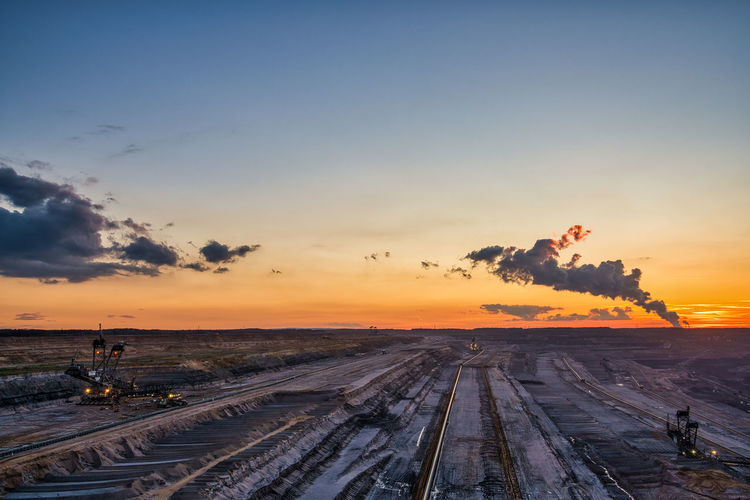High angle view of railroad tracks during sunset