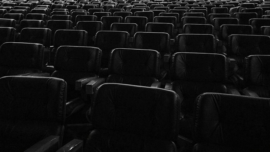 Full Frame Shot Of Empty Chairs In Theatre