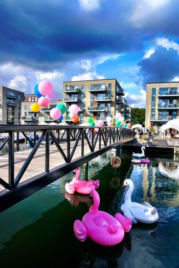 Water festival in my new City Vejle Eye4photography  Bridge Clouds And Sky Waterfront Water Streetphotography Water Festival Marina Vejle Denmark Mettebruus Mette Bruus Architecture Architecture_collection Marina Cloud - Sky Architecture Sky Built Structure Building Exterior Nature #urbanana: The Urban Playground Balloon Water Pink Color Multi Colored Celebration City Travel Destinations Inflatable  Summer In The City