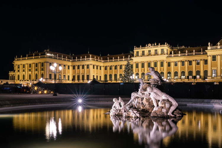 Schönbrunn Travel Destinations Night Illuminated Building Exterior Architecture Built Structure Reflection Water City Nature Travel Destinations Building Sculpture No People Waterfront Art And Craft Copy Space Sky Tree Motion Beautifulaustria Schönbrunn, Vienna Austria Schönbrunn Nightphotography Statue Castle Capture Tomorrow 2018 In One Photograph My Best Photo
