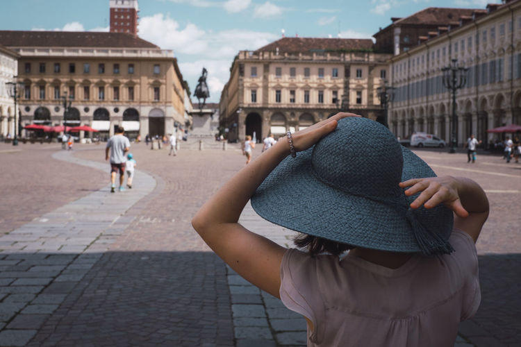 Rear view of woman wearing hat in city