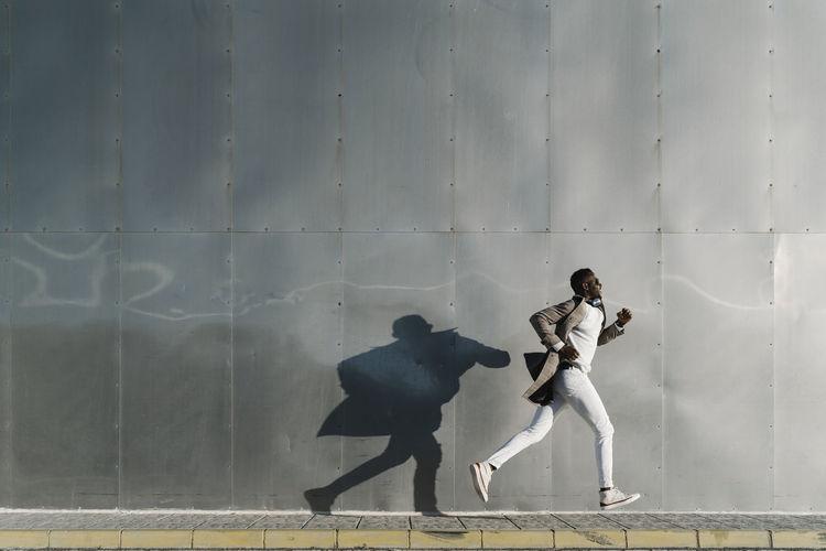 People walking on wall