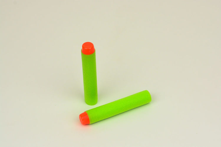Green foam soft bullet for toy gun on white background Bullet For Toy Close-up Foam Bullet No People Soft Bullet Studio Shot Toys White Background