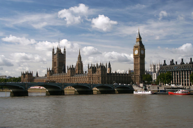 Big Ben And Cityscape Against Sky