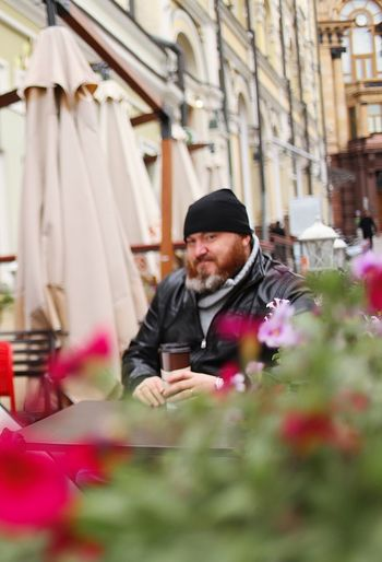 One Person Flower Real People Flowering Plant Selective Focus Adult Men Beard Front View Plant Waist Up Table Mid Adult Facial Hair Males  Casual Clothing Three Quarter Length Young Adult