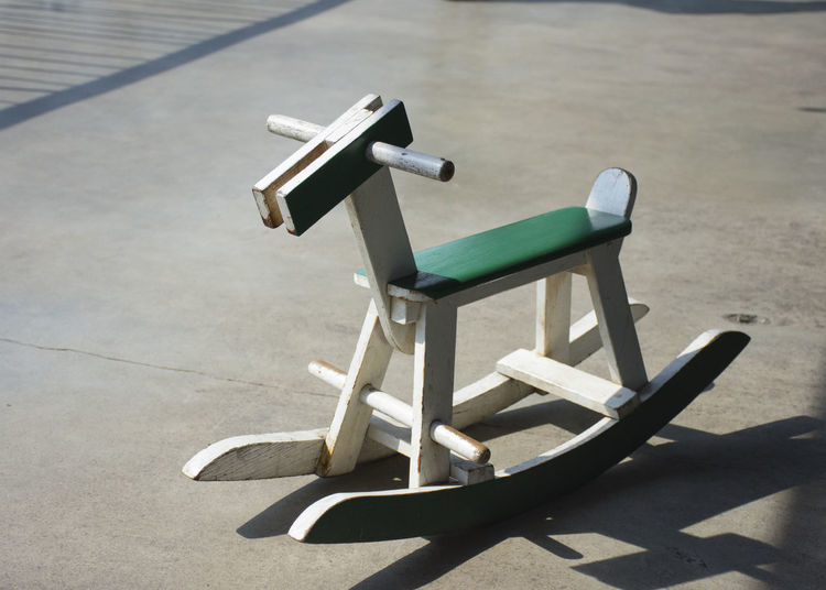 Close-up of rocking horse outdoors
