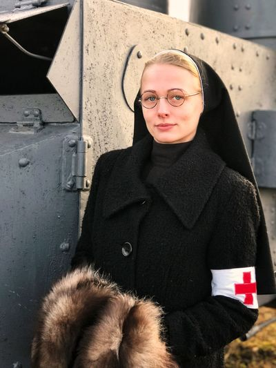 Portrait of nun standing outdoors