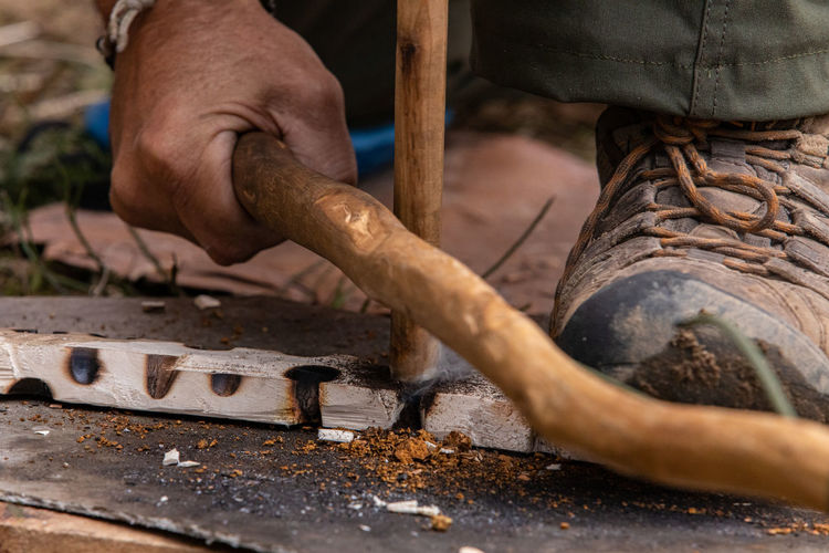 Close-up of man working on wood