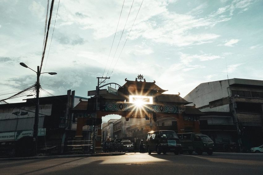 Sunset chasin' Lens Flare Street Sky Building Exterior Sunbeam Built Structure Architecture Transportation Street Light Car Sunlight Sun Outdoors Land Vehicle Road Cloud - Sky No People Day City