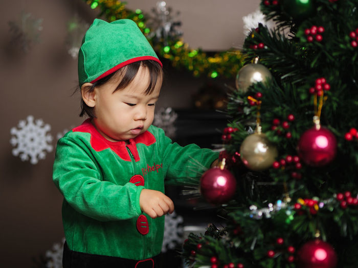 Asian Girl Celebration Childhood Christmas Christmas Decoration Christmas Ornament Christmas Tree Cute Green Color Holiday - Event Illuminated Indoors  One Person People Tree