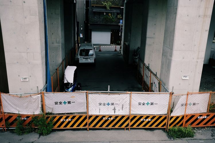 Architecture Building Building Exterior Built Structure Car City Connection Day Garage High Angle View Land Vehicle Mode Of Transportation Motor Vehicle No People Outdoors Railing Road Street Transportation Travel Truck