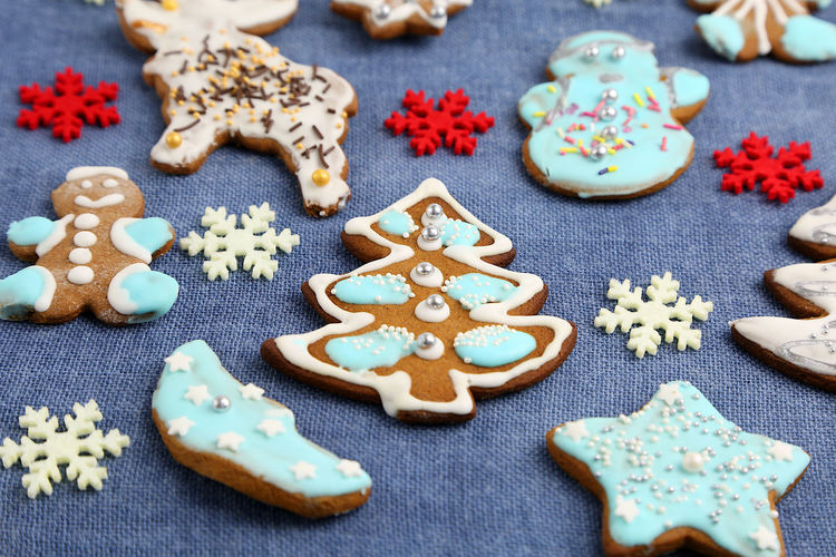 Christmas Cookies Gingerbread Homemade Food Decoration Colorful Colors Sweets Sweet Handmade Blue Background Textured  Sweet Food Baked Cookie Food And Drink Celebration Still Life Indulgence Indoors  Holiday Freshness Table Star Shape Gingerbread Cookie High Angle View No People Close-up Representation Temptation Icing Tree Star