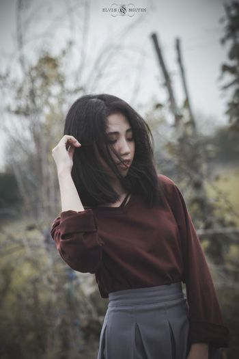Low wind One Person Young Adult Young Women Real People Three Quarter Length Focus On Foreground Long Hair Day Women Lifestyles Outdoors Beautiful Woman