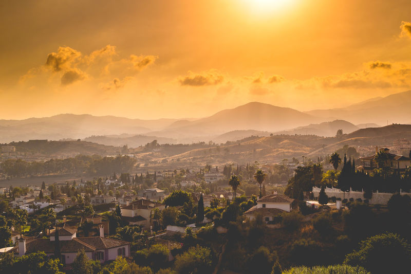 A beautiful sunset Andalucía Architecture Cloud - Sky Dusk Fog High Angle View Houses Landscape Mountain Mountain Peak Nature No People Orange Color Outdoors Palm Trees Scenics Sky SPAIN Sunset Travel Destinations First Eyeem Photo