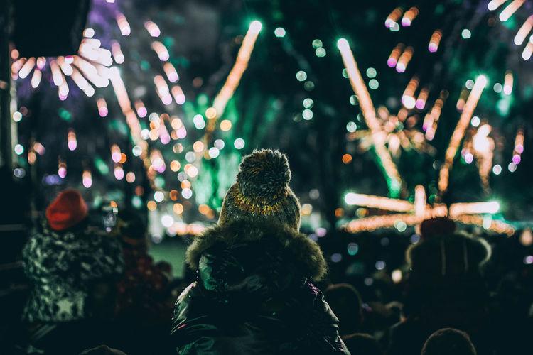 People watching firework display at night