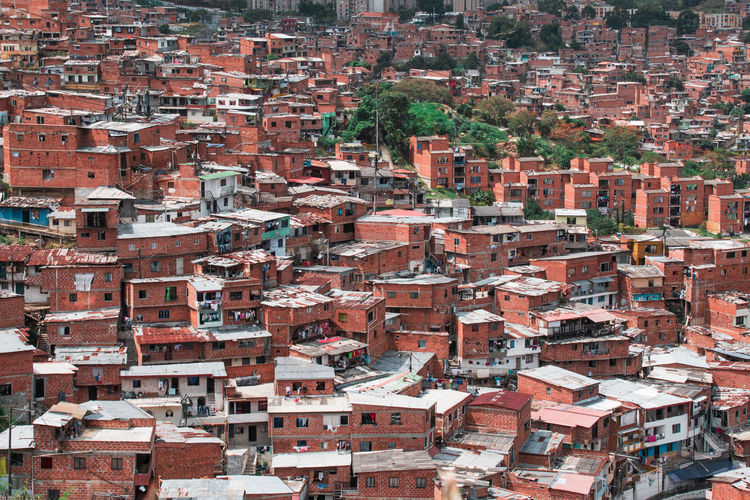 Medellin Colombia and the famous Comuna 13 Architecture Building Exterior Built Structure Building City Residential District Day Outdoors Crowd Crowded Cityscape Full Frame Community House Roof High Angle View Backgrounds Town City Life TOWNSCAPE Apartment Roof Tile Comuna 13 Comuna Colombia Slums Ghetto South America Streetphotography Art Grafitti Tele Cable