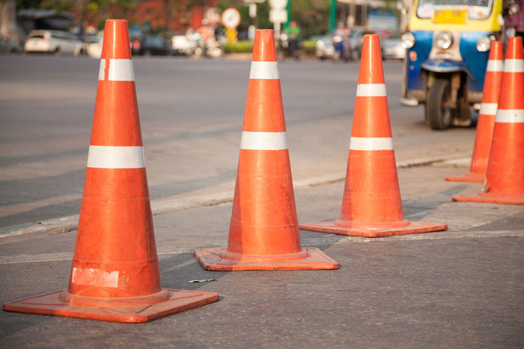 Traffic cones in row on city street