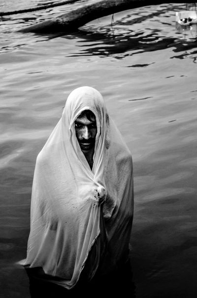 A dip in the river, early morning in devotion to the gods... Black And White Break The Mold Cloth Cold Day Devotee EyeEm Best Shots EyeEm Gallery EyeEmBestPics Lake Lone Man Man Standing Nature One Person Outdoors People Portrait Practices Real People Religion River Shroud Water Worship
