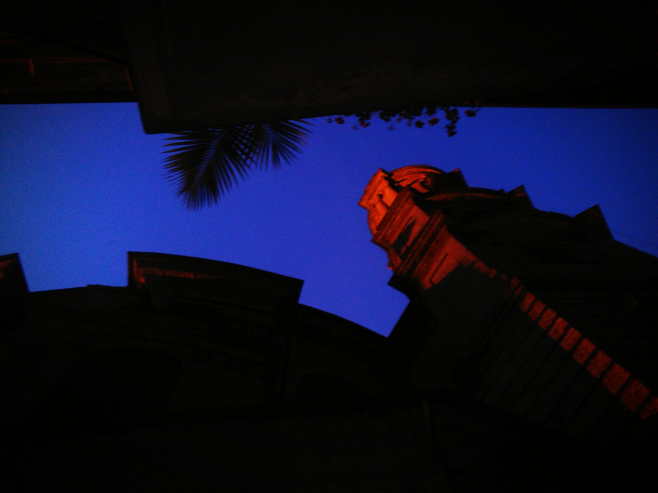 architecture, built structure, low angle view, building exterior, blue, clear sky, silhouette, place of worship, religion, sky, history, church, spirituality, copy space, dusk, outdoors, sunlight, building, no people