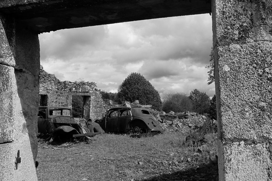 Abandoned cars at Oradour sur-glene Oradour Sur Glane Abandoned Damaged Day Field Mode Of Transport No People Obsolete Outdoors Run-down Sky Transportation