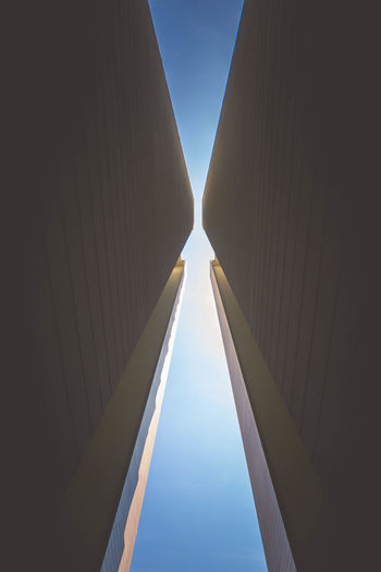 Pinched Between Architecture Blue Building Exterior Built Structure Cloud - Sky Day Low Angle View Monolithic  No People Outdoors Reflection Sky The Architect - 2018 EyeEm Awards #urbanana: The Urban Playground A New Perspective On Life