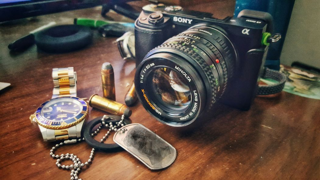 Still Life No People Sony A6000 Check This Out Mirrorless A6000 Bullets Invicta Timepeice Camera - Photographic Equipment Minolta Dogtags