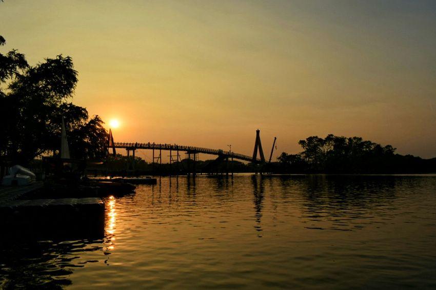 Sunset Reflection Water Outdoors Sky Nature Vacations Bridge Bridge Over Water Tree