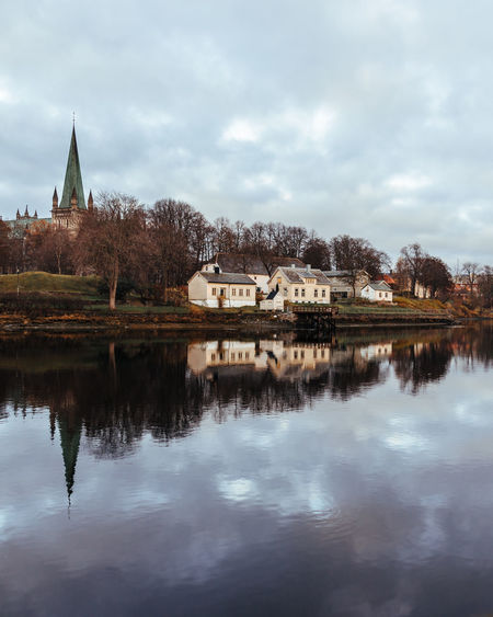 Norway Water Built Structure Building Exterior Reflection Architecture Building Cloud - Sky Sky Lake Nature Waterfront No People Tree Place Of Worship Religion Spirituality Day Outdoors Spire