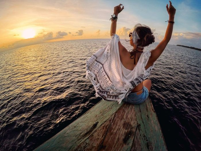Enjoy The New Normal Sunset cruise with the perfect groove One Person Sunset Full Length Lifestyles Sea Nature Water Outdoors Beauty In Nature Scenics Sky Young Women Young Adult Day