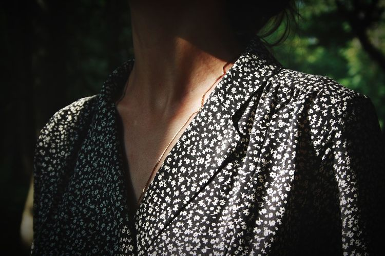 Midsection of woman standing outdoors