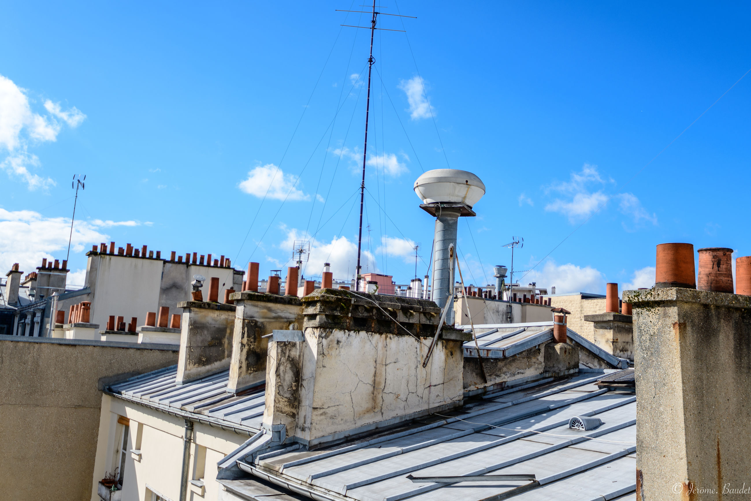 architecture, built structure, building exterior, sky, cloud - sky, day, building, nature, roof, no people, connection, sunlight, technology, antenna - aerial, blue, communication, outdoors, television aerial, city, residential district, roof tile