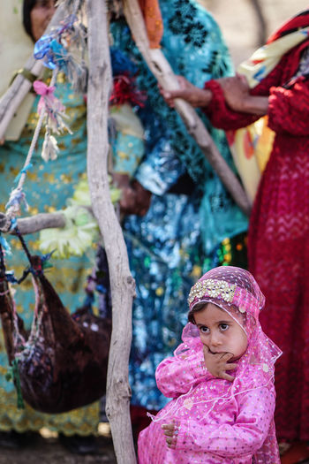 Travel Destinations Travel Photography Iran Shia Community Nomadic Zoroastrian Islamic Architecture Women Real People Lifestyles Leisure Activity Focus On Foreground Clothing Front View Portrait Females People Looking At Camera Child Pink Color Girls Childhood Traditional Clothing Emotion Innocence