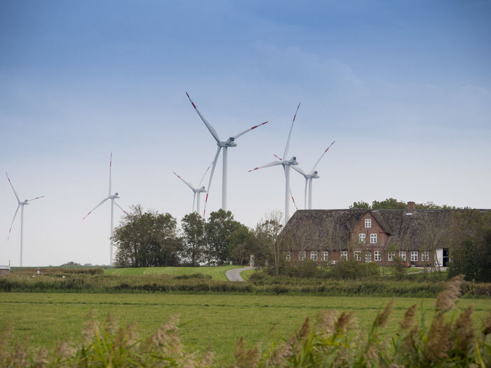 Germany Fuel And Power Generation Renewable Energy Alternative Energy Wind Turbine Environment Wind Power Turbine Environmental Conservation Sky Landscape Field Rural Scene Land Grass Nature Plant Day Technology Built Structure Architecture No People Outdoors Sustainable Resources