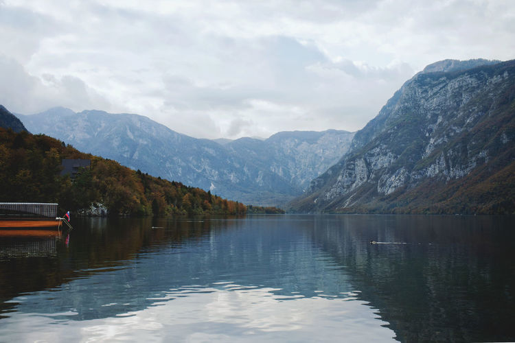 Autumn view of the beautiful bohinj lake with stunning transparent water against mountains.