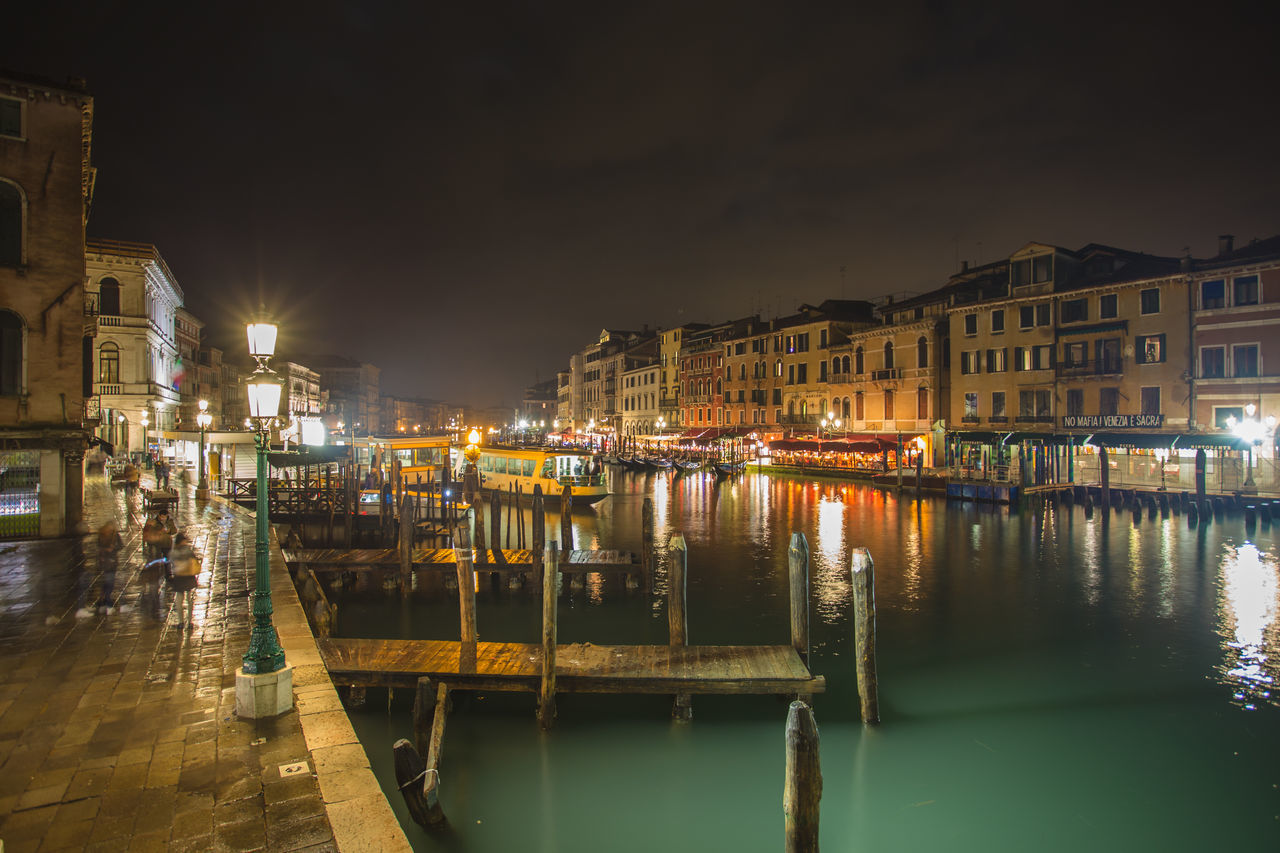architecture, building exterior, built structure, night, illuminated, water, reflection, moored, waterfront, no people, nautical vessel, outdoors, residential building, city, transportation, sky