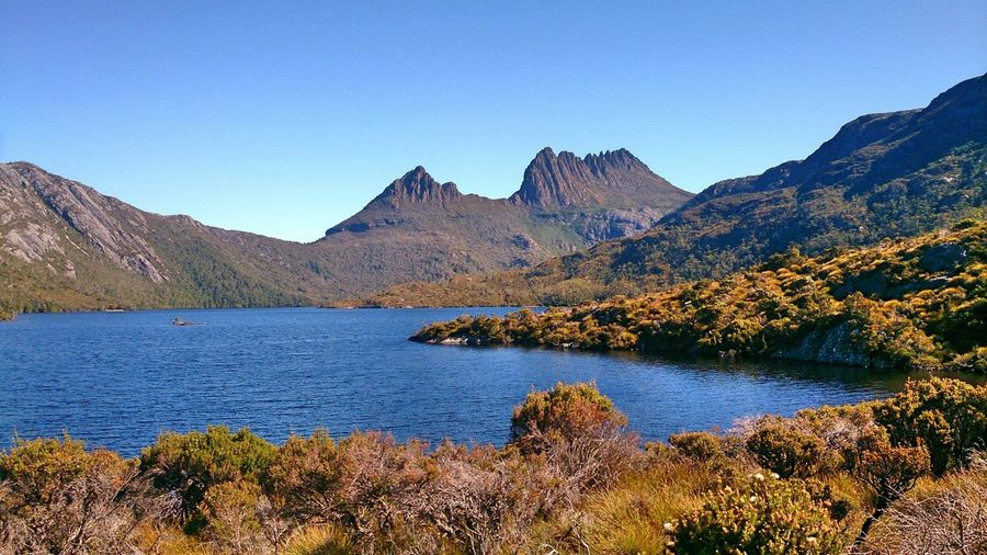 Idyllic shot of cradle mountain and lake st clair against clear sky
