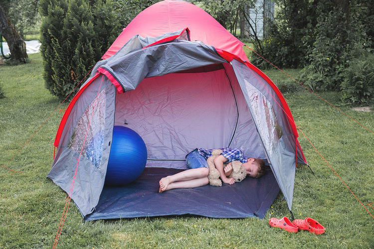 Child sleeping in a tent
