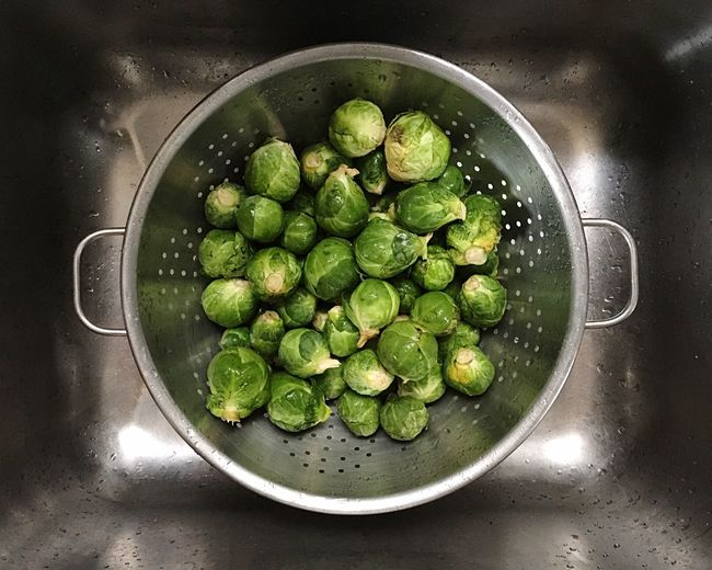 Directly above shot of brussels sprouts in colander