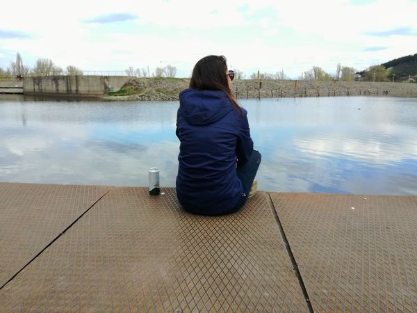 ... Rear View Water Only Women One Person Lake One Woman Only Adult Reflection Adults Only People Sitting Women Outdoors Day Sky Nature Young Women Young Adult Tranquility Beauty In Nature Blue Jeans Beautiful Woman Woman Around The World Woman Legs Woman In Blue