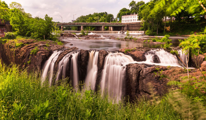 Great Falls in Paterson, NJ National Park New Jersey Architecture Beauty In Nature Blurred Motion Bridge - Man Made Structure Built Structure Day Environment Flowing Flowing Water Hydroelectric Power Landscape Long Exposure Motion Nature No People Outdoors Park Plant River Scenics - Nature Tree Water Waterfall EyeEmNewHere Creative Space The Traveler - 2018 EyeEm Awards The Great Outdoors - 2018 EyeEm Awards Summer Road Tripping