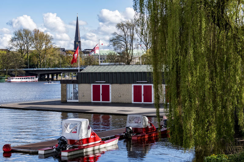 Außenalster Architecture Außenalster Bare Tree Beauty In Nature Boat Building Exterior Built Structure Church Tower Cloud - Sky Day Hamburg Mode Of Transport Moored Nature Nautical Vessel No People Outdoors River Sky Transportation Tree Water Waterfront