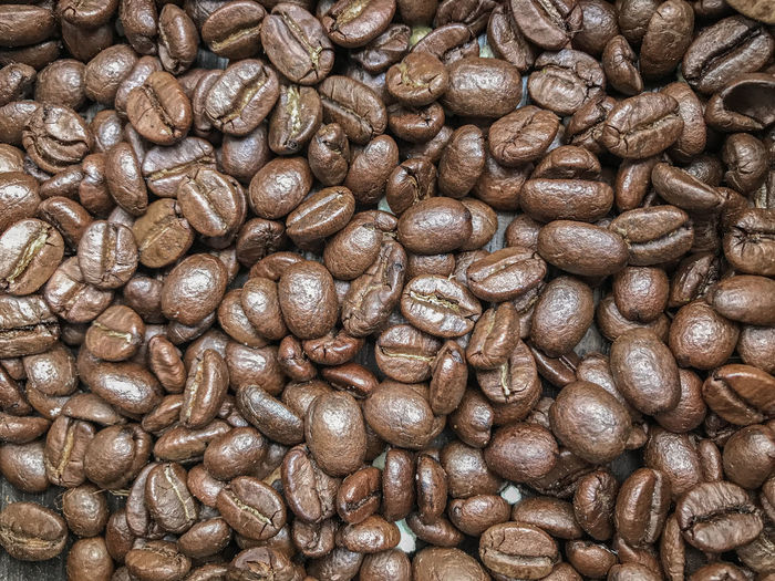 Roasted fresh coffee beans stack background. Raw Object Dark Light Seed Tasty Design Stack Group Prepare Fresh Morning Awake Style Retro Food Shape Frame Material Arabica Black Ingredient Background Full Roasted Coffee Bean Brown Gourmet Space Pattern Caffeine Beverage Grain Cafeteria Porcelain  Saucer Energy Breakfast Aroma Crop  Restaurant Espresso Backdrop Agriculture Texture Drink Freshness Mocha Color