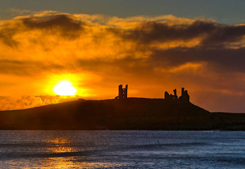 Dawn is red Craster Dunstanburgh Castle Embleton Morning Light Beauty In Nature Castle Ruin Dawn Day Nature No People Orange Color Outdoors Scenics Silhouette Sky Sunlight Sunrise Sunset Tranquility Water Waterfront Winter Dawn