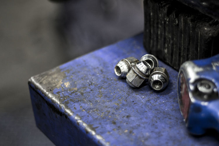 Bolts closeup with grunge background Close-up Day Factory Indoors  Industry Metal Metal Industry No People Table Focus On Foreground Indoors  High Angle View Hand Tool