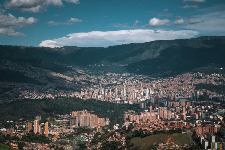 Exploring the city of Medellín. Architecture Building Exterior Built Structure City Nature Outdoors Travel Destinations South America Latin America Explore Urban Mountain Cityscape Cloud - Sky Sky Building Residential District Mountain Range Crowd Day High Angle View Crowded Scenics - Nature Landscape TOWNSCAPE