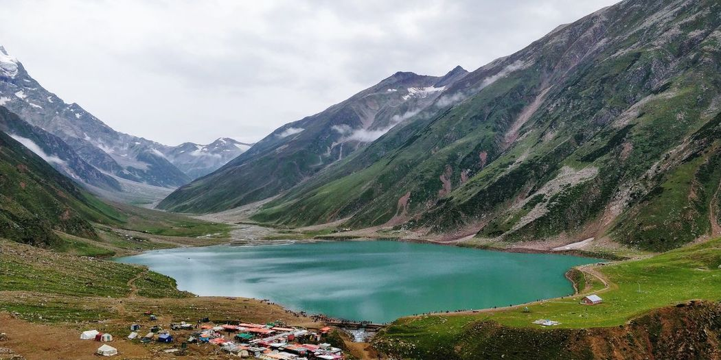 Scenic view of saif-ul-mulk lake and mountains against sky